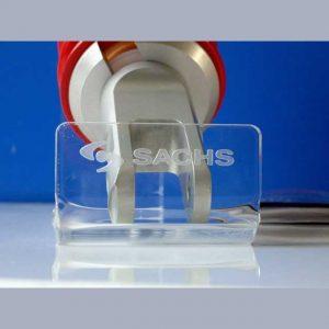 Espositore plexiglass marcatura laser Sachs per l'industria, minimaliste, trasparente, è costruito per sopportare un prodotto pesante.