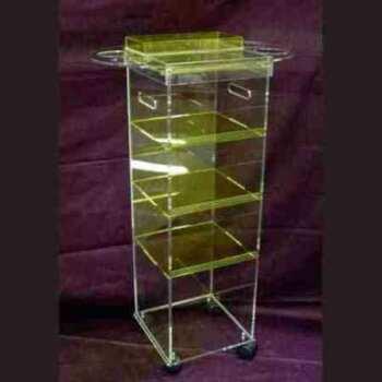 Chariot de service à colonne plexiglas pour coiffeur est une partie du mobilier design en plexiglas total look transparent et jaune fluo