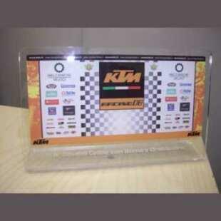 """Trophée sportif Plexiglas moto KTM en transparent 5 mm, impression directe pour une course d'enduro de la KTM. Découpe laser. Pliure à """"L"""""""
